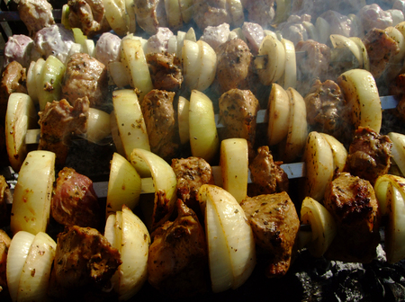 Grilling shashlik is cooked on fire. Grilled meat.