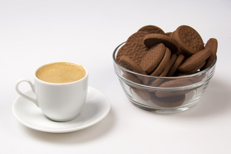 colombian food: Cup of espresso and biscotti. White background. Stock Photo