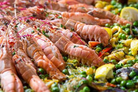 Traditional spanish paella with seafood and pork. Prepared