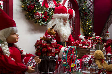 Santa Claus, Christmas scene with presents and objects from trees. Christmas decoration