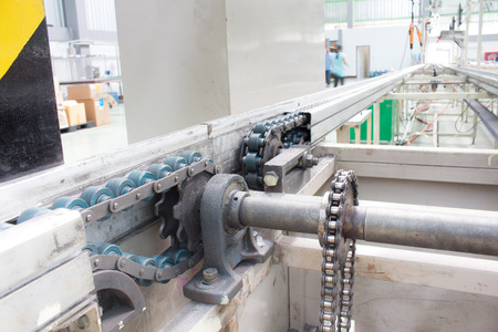 shaft: the chain drive shaft Line Conveyor Industrial Stock Photo