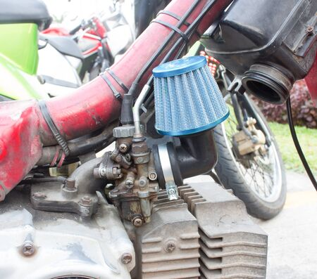 Motorcycle carburetor with custom made air filter box Stock Photo