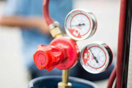 The pressure gauge and valve on lpg tank Stockfoto