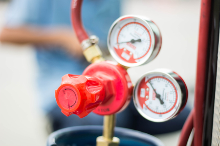 The pressure gauge and valve on lpg tank Standard-Bild