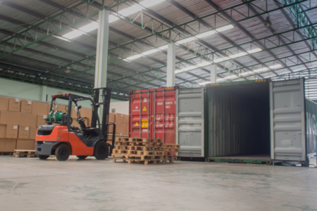 The forklift loading pallet with a forklift into a truck.(Blur picture) 免版税图像