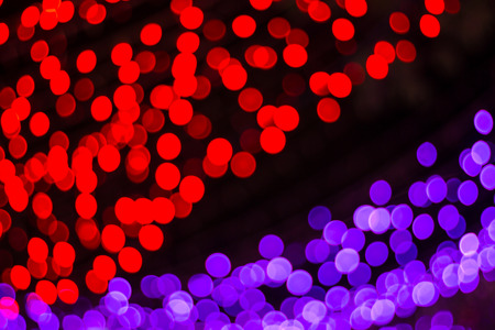 The light red bokeh blurred abstract light background