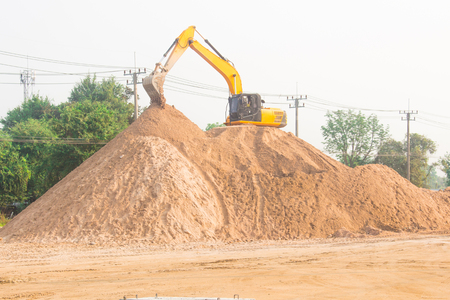 large diesel mechanical excavator digging earth machine at excavation working in road construction