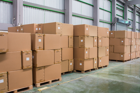 Rows of material boxes or product boxes in warehouse area.