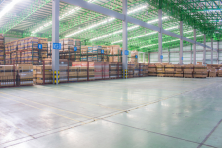 The Yellow Line breaks of empty space for keep material boxes or product boxes in warehouse area.(Blur picture)