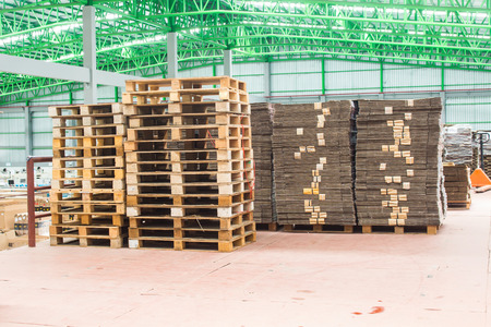 The wooden pallets, pallets ready for use packing keep material boxes or product boxes in warehouse area. Banco de Imagens