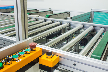 The emergency stop button on conveyor chain, and conveyor belt or auto machine  in production line area.