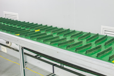The conveyor chain, and conveyor belt on production line set up in clean room area.