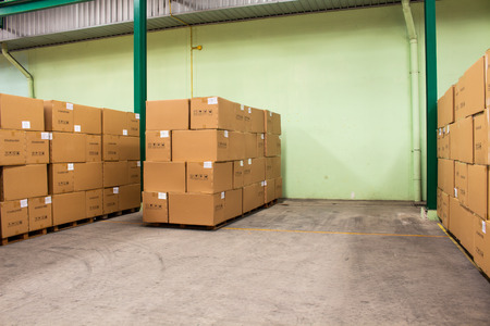 The rows of material boxes or product boxes in warehouse area.
