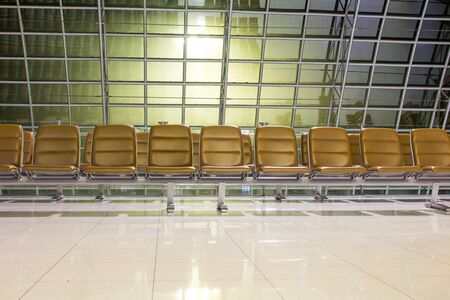 The empty airport terminal waiting area with chairs in night