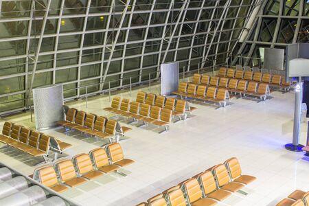 The empty airport terminal waiting area with chairs in night Banco de Imagens - 131965771
