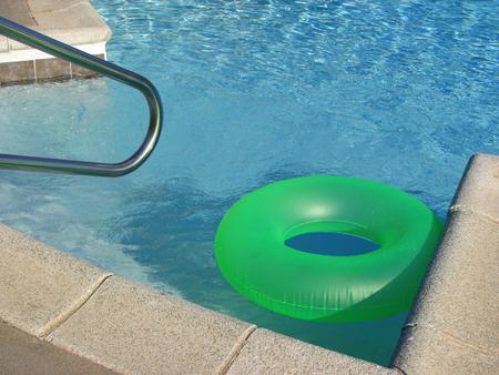 Green pool toy inner tube float  Stock Photo