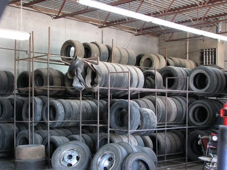 tire tread: Rack of Tires at Tire Shop