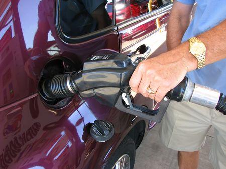 unleaded: Man pumping Gas