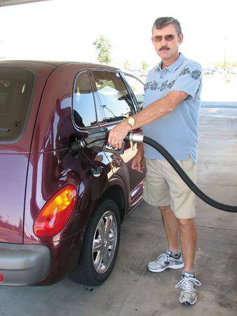 pumping: Senior Man Pumping gas