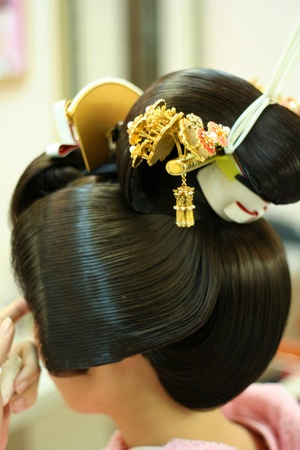 kanzashi: Japanese Geisha getting ready for her performance Stock Photo
