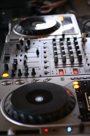 deejay: a deejay console with mixers in the middle