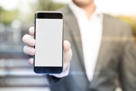 give out: businessman asian show gadget smart phone for review product social media marketing in business have white isolated for retouch Stock Photo