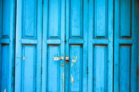 Ancient Blue Door with old school lock