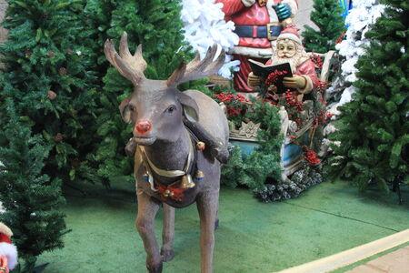christmas carols: Christmas Father with sledge & reindeer