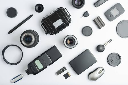 Flat assembly composition with photographic production equipment, with central writing space, on white background. Top view