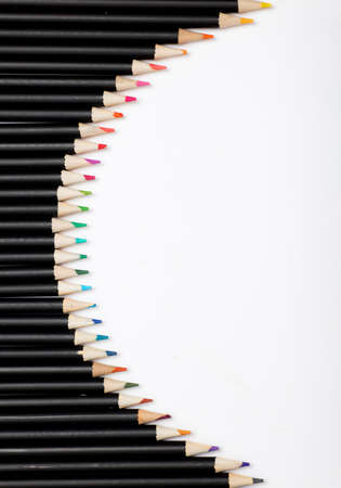 Black pencils with colored tips, white background
