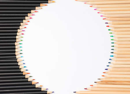 White background with colored pencils. Circular frame