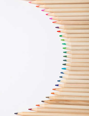 Wooden pencils with colored tips, white background