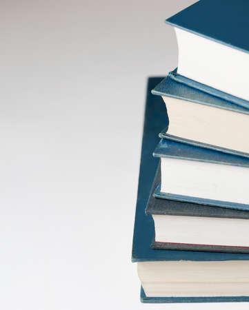 blue books on white background Imagens