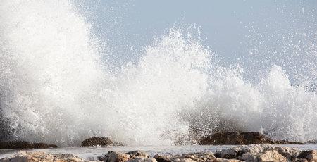 Waves splashed over rocks on a very windy day Reklamní fotografie