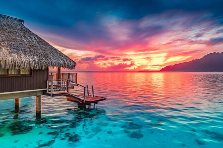 Stunning colorful sunset sky of Moorea, South Pacific Ocean. Stock Photo