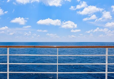 Railing of cruise ship with ocean view.