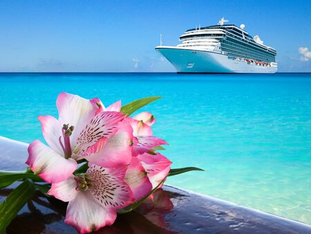 Luxury cruise vacation concept. Pink blooming Alstoemerira flower on wooden railing. Archivio Fotografico