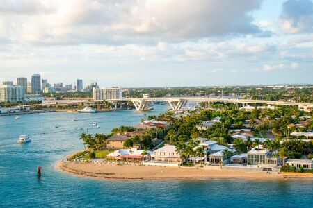 Fort Lauderdale landscape with small beach and bridge at Port Everglades.