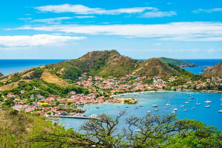 Terre-de-Haut, Guadeloupe. Colorful landscape with village, bay and mountains.