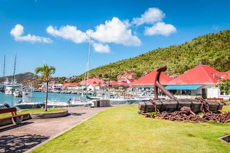 Gustavia, harbor landscape with red rooftop buildings. Saint Barthelemy, St Barts, St Barths. Фото со стока - 149992228