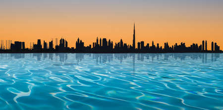 Dubai skyline. Panoramic view with silhouette of the city at sunset.