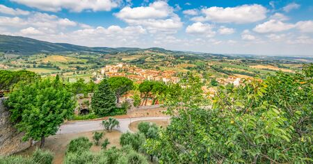 Viewpoint over hill town at San Gimignano. Beautiful landscape of Tuscany in Italy. Фото со стока