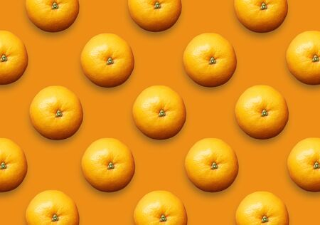 Whole fresh oranges on orange background. Set of colorful citrus fruit pattern.