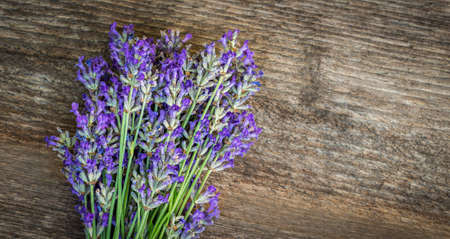 Lavender flowers on wooden background. Close up.