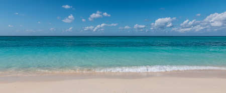 Panoramic view of tropical white sand beach and sea of ​​the Cayman Islands.
