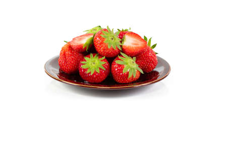 Strawberry plate isolated on a white background. Red juicy organic Belgian strawberries.