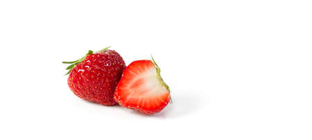 A whole and a half red organic juicy, fresh Belgian strawberry isolated on a white background with space for text.
