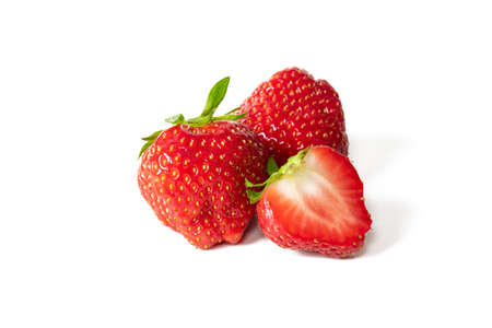 Fresh juicy strawberries isolated on a white background.