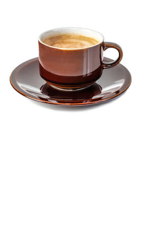An antique brown shiny cup filled with delicious frothy double espresso coffee isolated on a white background.
