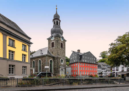 Church and colorful buildings in city center of Monschau